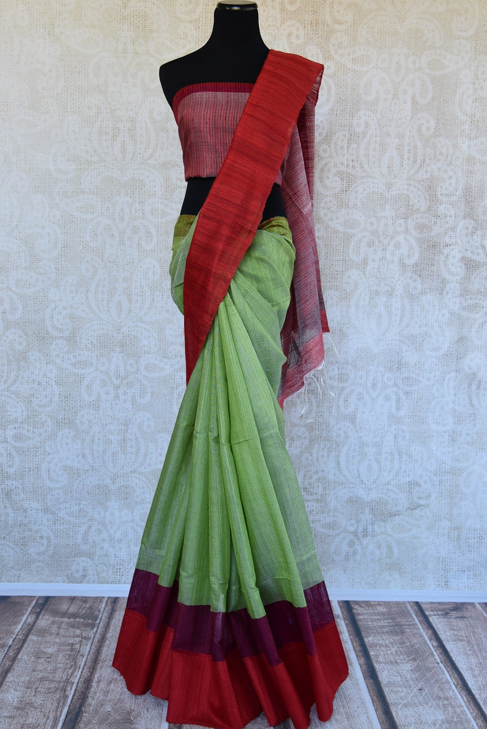 Matka silk saree in pista green and red color. Perfect saree for casual Indian gatherings and pujas.-full view