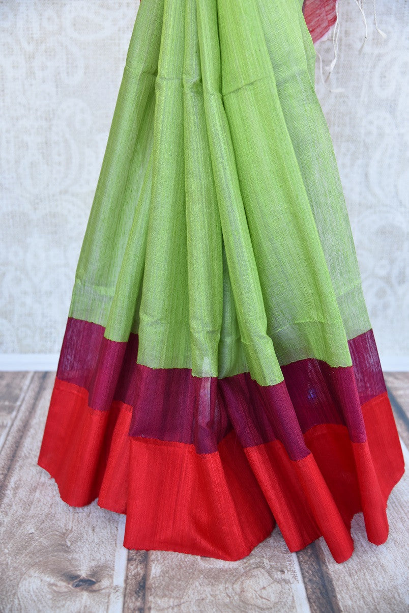 Matka silk saree in pista green and red color. Perfect saree for casual Indian gatherings and pujas.-red border