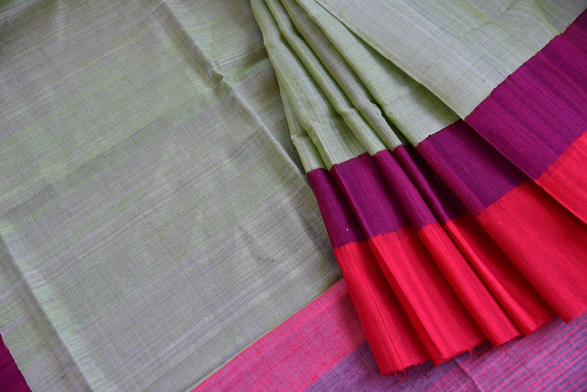 Matka silk saree in pista green and red color. Perfect saree for casual Indian gatherings and pujas.-close up