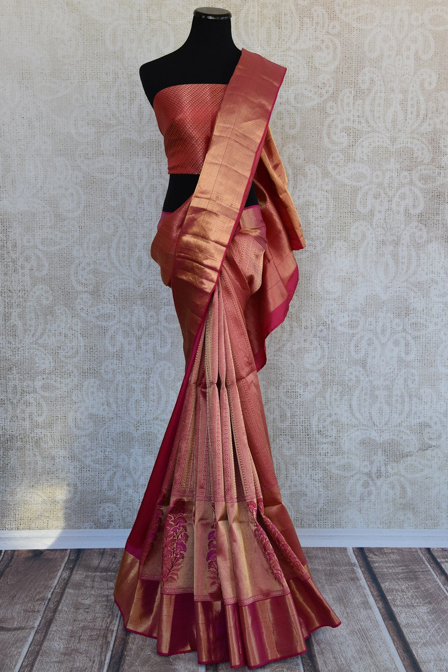 Kanjivaram silk pinkish red and gold saree with big floral buta through the border. Perfect for weddings.-Full view