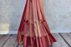 Kanjivaram silk pinkish red and gold saree with big floral buta through the border. Perfect for weddings.-pleats and border