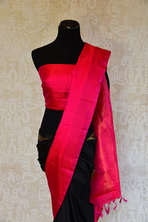 Kanchivaram silk black and pink saree. Traditional saree perfect for Indian wedding functions and gatherings.-pallu