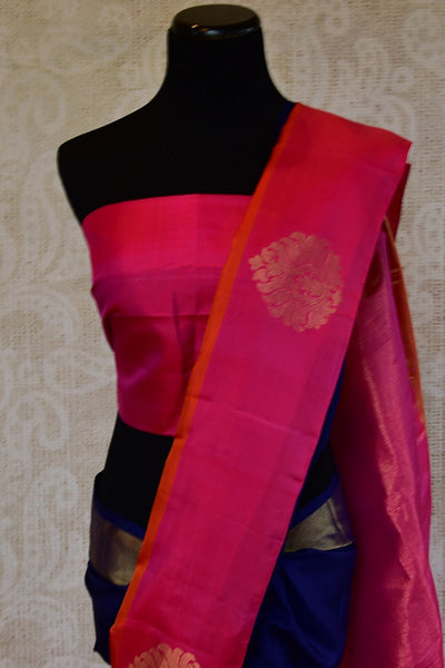 Kanchivaram silk blue saree with pink and orange classic border and pallu. Perfect sari for Indian wedding functions and gatherings.-buta on pallu