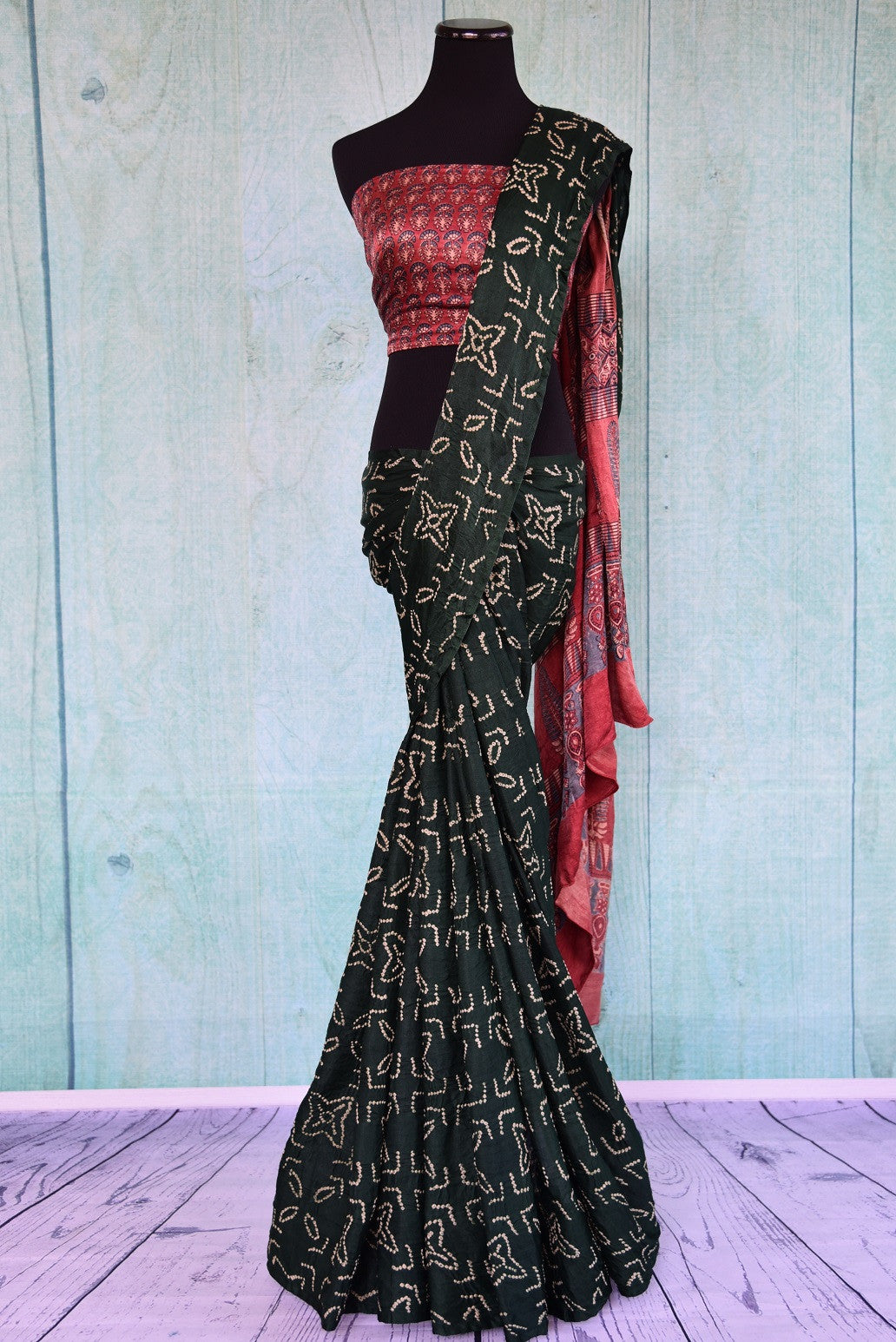 90D066 Green & beige bandhej body is teamed with multi-color ajrak printed blouse & pallu in this saree. Buy this nine yard Indian outfit online in USA at our store Pure Elegance.