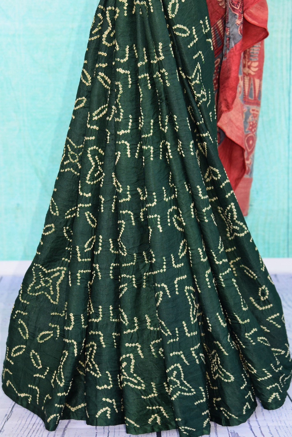 90D066 Green & beige bandhej body is teamed with multi-color ajrak printed blouse & pallu in this saree. Buy this nine yard Indian outfit online in USA at our ethnic fashion store Pure Elegance.