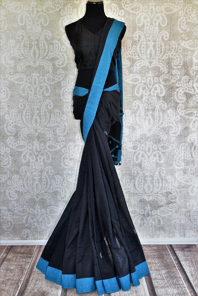 Buy black Linen saree online with a readymade designer blouse from Pure Elegance or visit our store in USA. Pick from a range of beautiful Indian saris online in USA.-full view