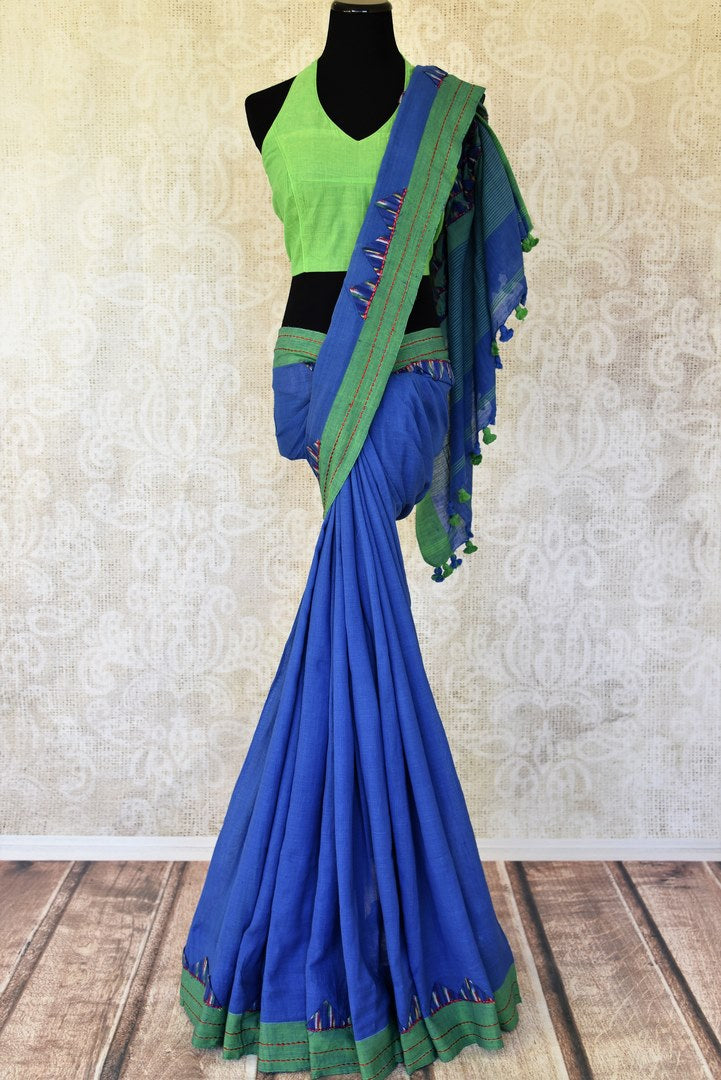 Buy stylish blue linen ikat saree online in USA with green saree blouse. Shop more such exquisite Indian handloom saris in USA from Pure Elegance. Get floored by a range of designer sarees, pure silk sarees, Kanchipuram silk saris at our Indian fashion store in USA.-full view