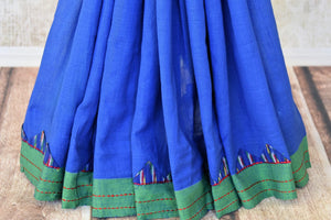 Buy stylish blue linen ikat saree online in USA with green saree blouse. Shop more such exquisite Indian handloom saris in USA from Pure Elegance. Get floored by a range of designer sarees, pure silk sarees, Kanchipuram silk saris at our Indian fashion store in USA.-pleats