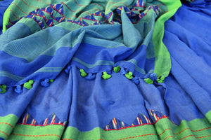 Buy stylish blue linen ikat saree online in USA with green saree blouse. Shop more such exquisite Indian handloom saris in USA from Pure Elegance. Get floored by a range of designer sarees, pure silk sarees, Kanchipuram silk saris at our Indian fashion store in USA.-details