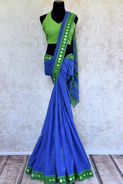 Buy beautiful blue Linen sari online with mirror border from Pure Elegance or visit our store in USA. Shop from a range of beautiful woven Indian saris online in USA.-full view