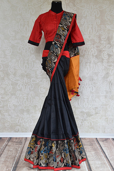It's a black raw silk printed sari with red blouse and yellow pallu. Has geometric design in border and figure design in bottom border. Perfect for party, occasion - front view