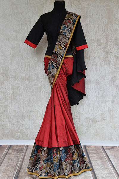 It's raw silk red kalamkari printed sari with black blouse. Has figure in back of the blouse and in the border. It has thin yellow border. Perfect for party. front view