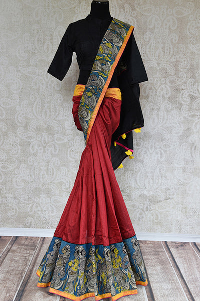 Its raw silk printed red sari with black blouse and pallu. Blouse has yellow color and figure. Has thin yellow border and figure design. Perfect for party, occasion. front view
