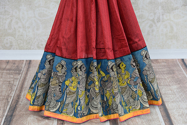 Its raw silk printed red sari with black blouse and pallu. Blouse has yellow color and figure. Has thin yellow border and figure design. Perfect for party, occasion - bottom view
