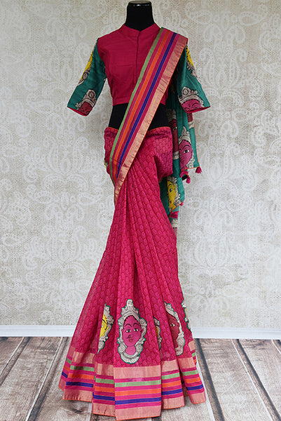 It's a red kalamkari printed sari with geometric pattern in the bottom. Blouse is red colored with green sleeves. sari has human figure design and green pallu. front view