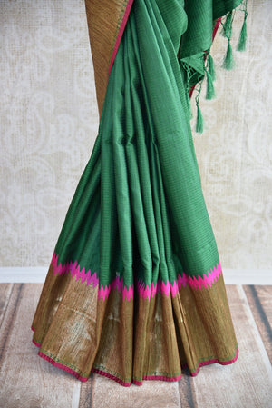 Buy online dark green muga Banarasi saree online in USA. Explore a collection of Indian designer sarees in USA at Pure Elegance online store or visit our fashion store in USA.-pleats