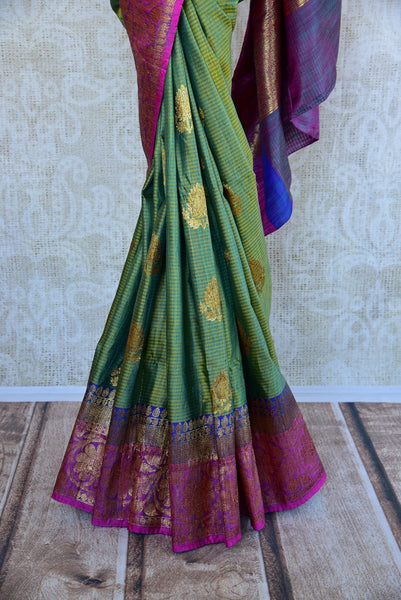 Buy online green muga Banarasi sari online in USA. Explore a collection of exquisite Indian designer sarees in USA at Pure Elegance online store or visit our fashion store in USA.-pleats