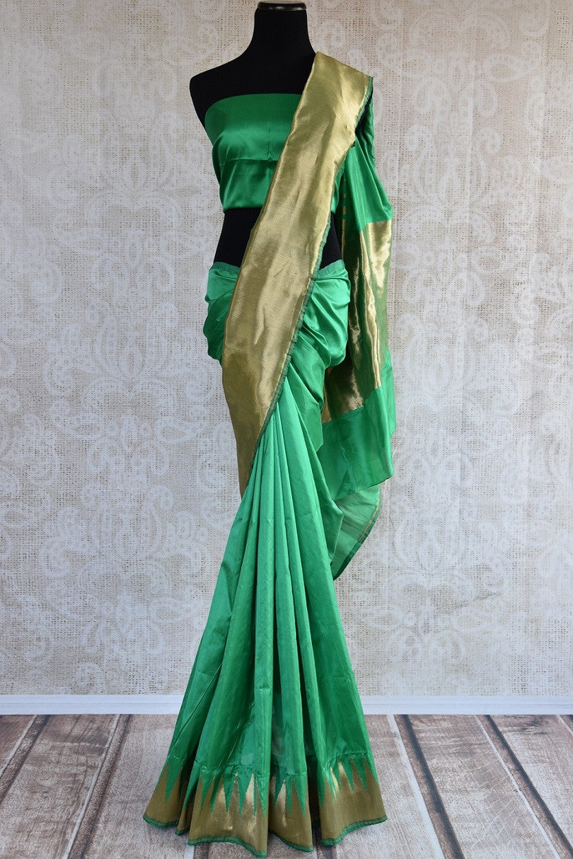 Buy green Banarasi silk saree online from Pure Elegance. Our Indian fashion store in USA brings an exquisite collection of woven Banarasi sarees in USA for women.-full view