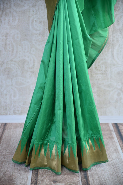 Buy green Banarasi silk saree online from Pure Elegance. Our Indian fashion store in USA brings an exquisite collection of woven Banarasi sarees in USA for women.-pleats