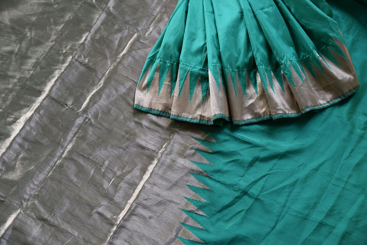 Buy green Banarasi silk saree online from Pure Elegance. Our Indian fashion store in USA brings an exquisite collection of woven Banarasi sarees in USA for women.-details