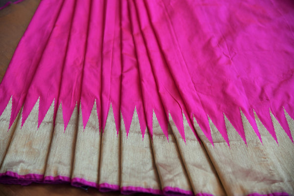 90D190 The ethnic Indian woven benarasi silk sari is available online at Pure Elegance as well as the store in USA. It is perfect for any sangeet or engagement party.  Golden Border on Pink Banarasi silk.
