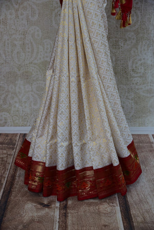 90D201 Traditional White & Red Silk Tissue Saree