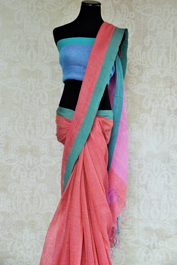 Shop pink and blue linen  sari with pallu in two hues of pink online. This Indian linen sari can be a party wear, or a casual wear sari. Buy this saree online at our ethnic clothing store Pure-Elegance in USA.