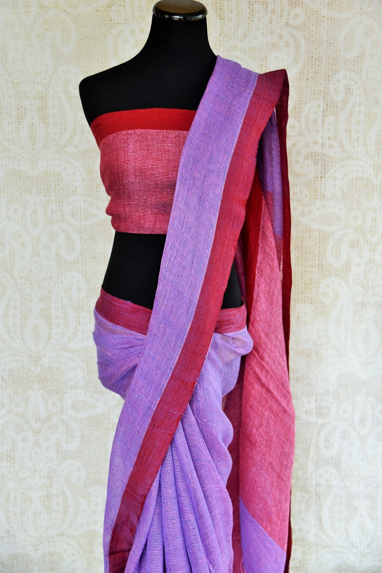 Shop lavender and maroon linen Indian sari with maroon pallu online in USA. This Indian linen sari can be a party wear, or a casual wear sari. Buy this saree online at our ethnic clothing store in Pure-Elegance in USA.