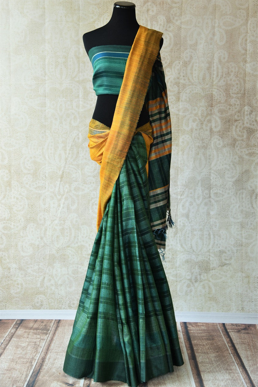 Green and yellow pashmina silk saree.This Bhagalpur saree perfect for Indian events like pujas and festivals. Add in your Ethnic collection of sarees.-Full view