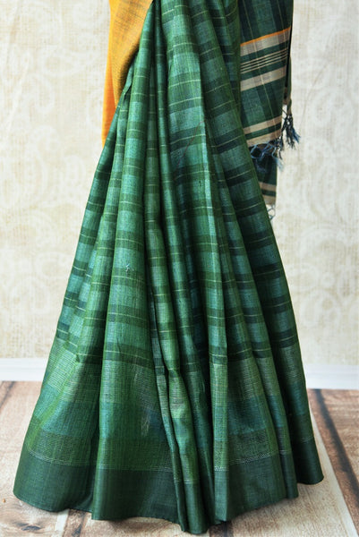 Green and yellow pashmina silk saree.This Bhagalpur saree perfect for Indian events like pujas and festivals. Add in your Ethnic collection of sarees.-pleats