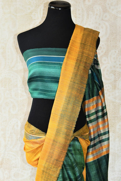 Green and yellow pashmina silk saree.This Bhagalpur saree perfect for Indian events like pujas and festivals. Add in your Ethnic collection of sarees.-pallu
