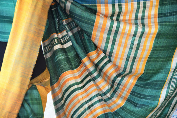 Green and yellow pashmina silk saree.This Bhagalpur saree perfect for Indian events like pujas and festivals. Add in your Ethnic collection of sarees.-close up