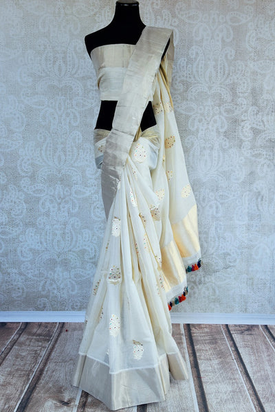 90D302 White Benarasi Indian Saree With Golden Butas