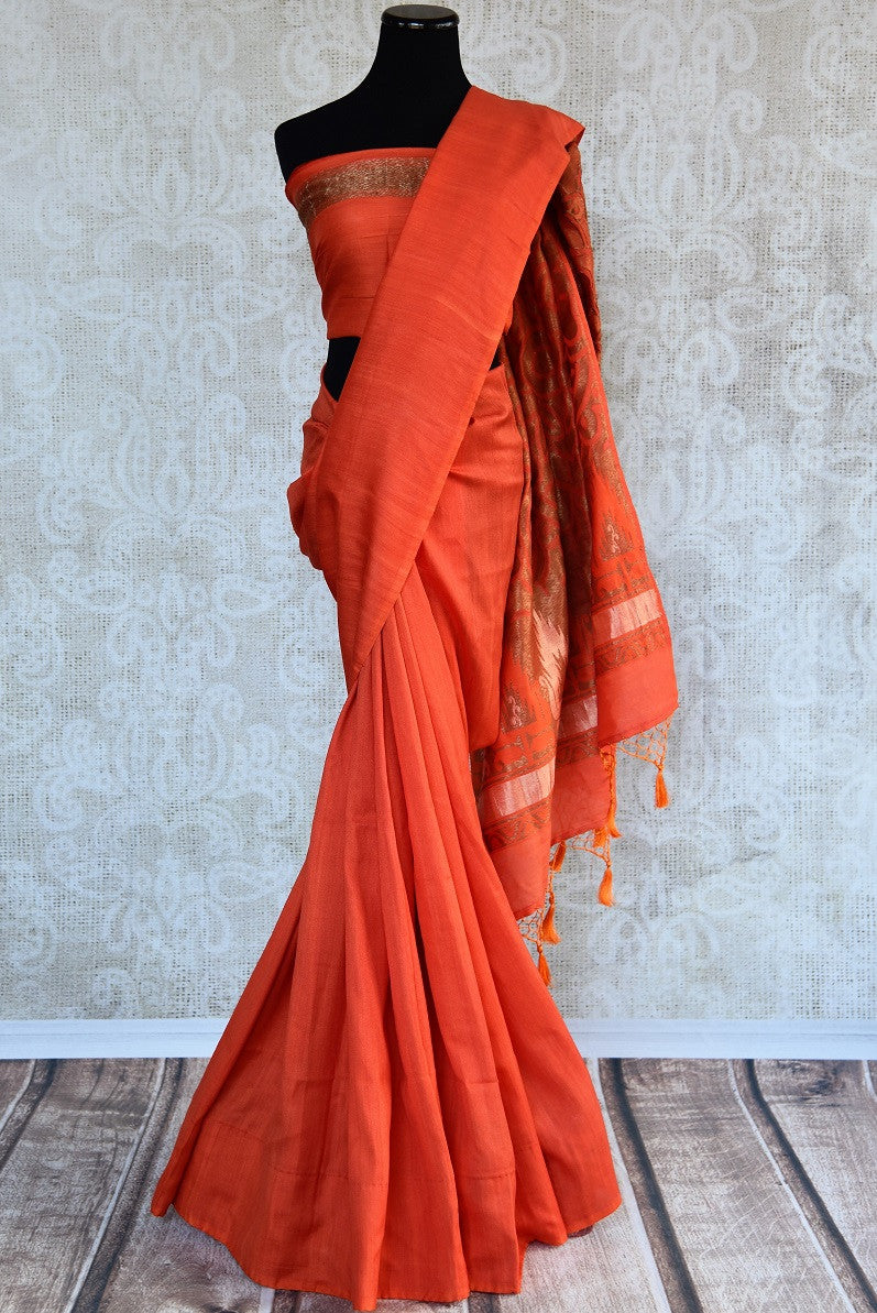 90d317 This tussar georgette Banarasi saree is sure to have you looking ravishing. Buy this orange colored simple sari at our Indian clothing store online in USA. This ethnic outfit is perfect for pujas and desi festivities.