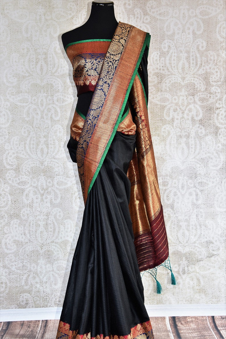90D319 Marvelous plain black saree with heavy blue, red, green border. The muga tussar Banrasi sari can be bought online at our Indian clothing store online in USA. This evergreen saree is sure to be loved by you for very any years to come!