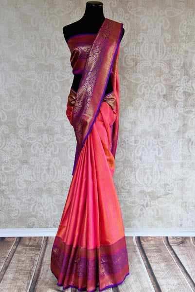 90D320 - Traditional pink sari with purple and golden border available at our online Indian clothing store in USA. This muga tussar Banarasi saree is perfect for Indian weddings and festive occasions and is sure to have all eyes on you!