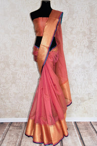90D325 Pink & golden maheshwari silk saree with a silk patti and blue trim, perfect for Indian weddings & pujas. Buy this simple sari online at our ethnic wear store online USA. The traditional saree is something you just cannot go wrong with.
