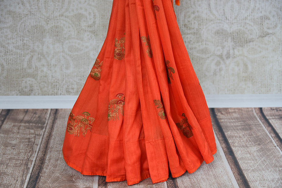 Buy this elegant orange muga tussar banarasi silk Indian saree with printed design from Pure Elegance store with blouse piece. Great for parties and festivals-Woven Design
