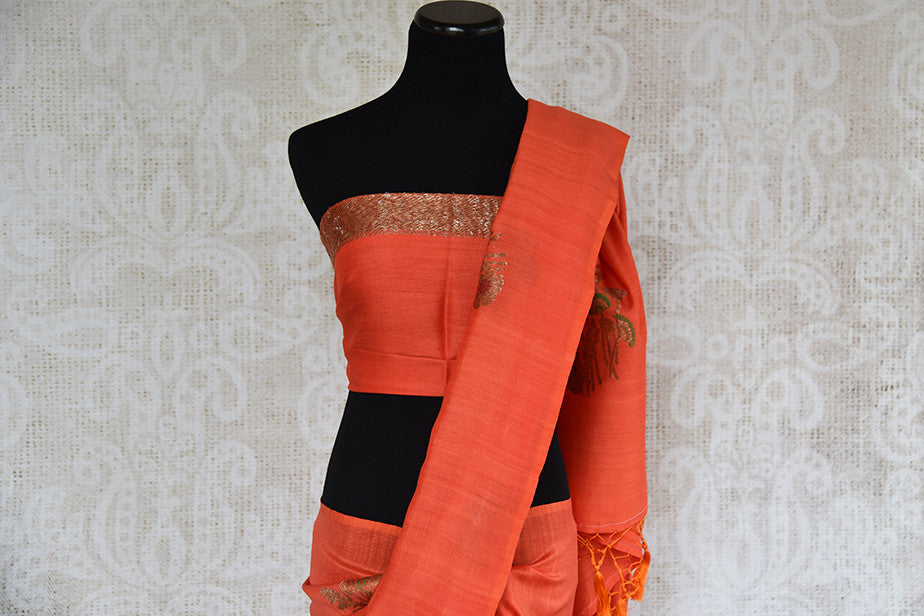 Buy this elegant orange muga tussar banarasi silk Indian saree with printed design from Pure Elegance store with blouse piece. Great for parties and festivals-Blouse and Pallu
