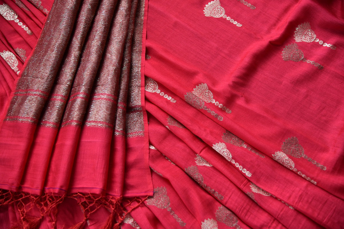 90D341 Red & golden muga Banarasi saree available online at our women's ethnic clothing store in USA. The traditional saree is an ideal outfit for Indian weddings, sangeets & receptions and will team well with traditional jewelry.