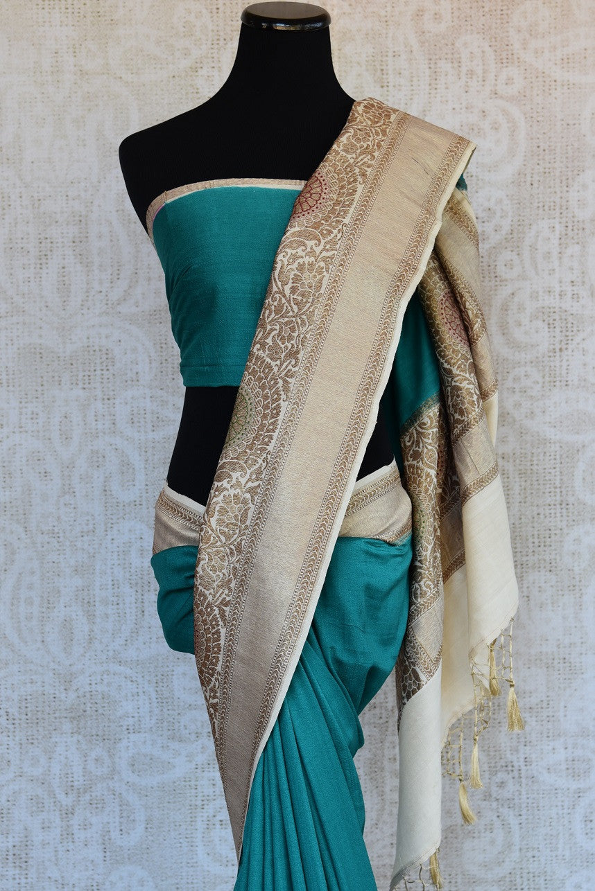 90D343 Lovely simple blue sari with a traditional printed beige border ideal for pujas and ethnic occasions. Buy this muga Banarasi saree at our Indian clothing store in USA online, or in Edison.