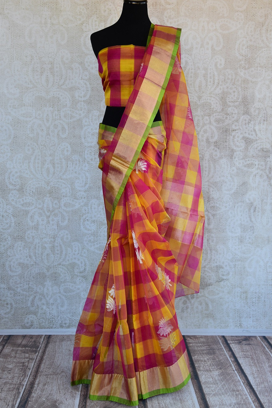 90D348 Checked, yellow & pink sari available at our ethnic fashion store online in USA. The bold silk chanderi saree is ideal for pujas and Indian gatherings and can be styled in both, traditional and modern ways.