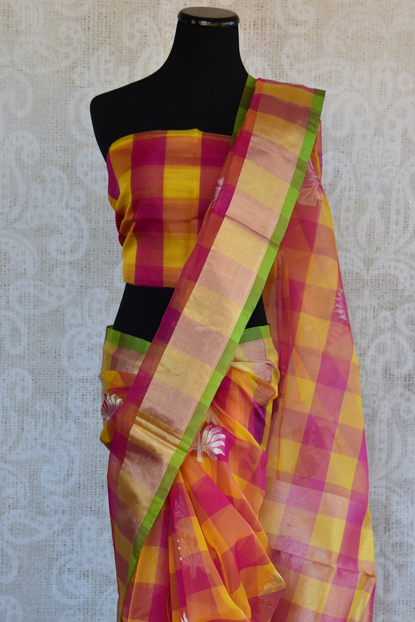 90D348 Checked, yellow & pink sari available at our ethnic fashion store online in USA. The bold silk chanderi saree is ideal for pujas and Indian gatherings and can be styled in both, traditional and modern ways