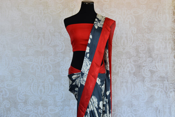 90D349 Floral saree that makes for the perfect party wear Indian outfit. The grey and white printed saree with red border and blouse can be bought online in USA at our ethnic wear store - Pure Elegance.