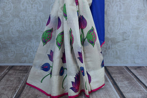 90D350 Bold white, blue & pink party wear saree available online at our Indian fashion website - Pure Elegance. The kota silk floral saree will be a great addition to your ethnic wear collection and is sure to turn heads wherever you go!