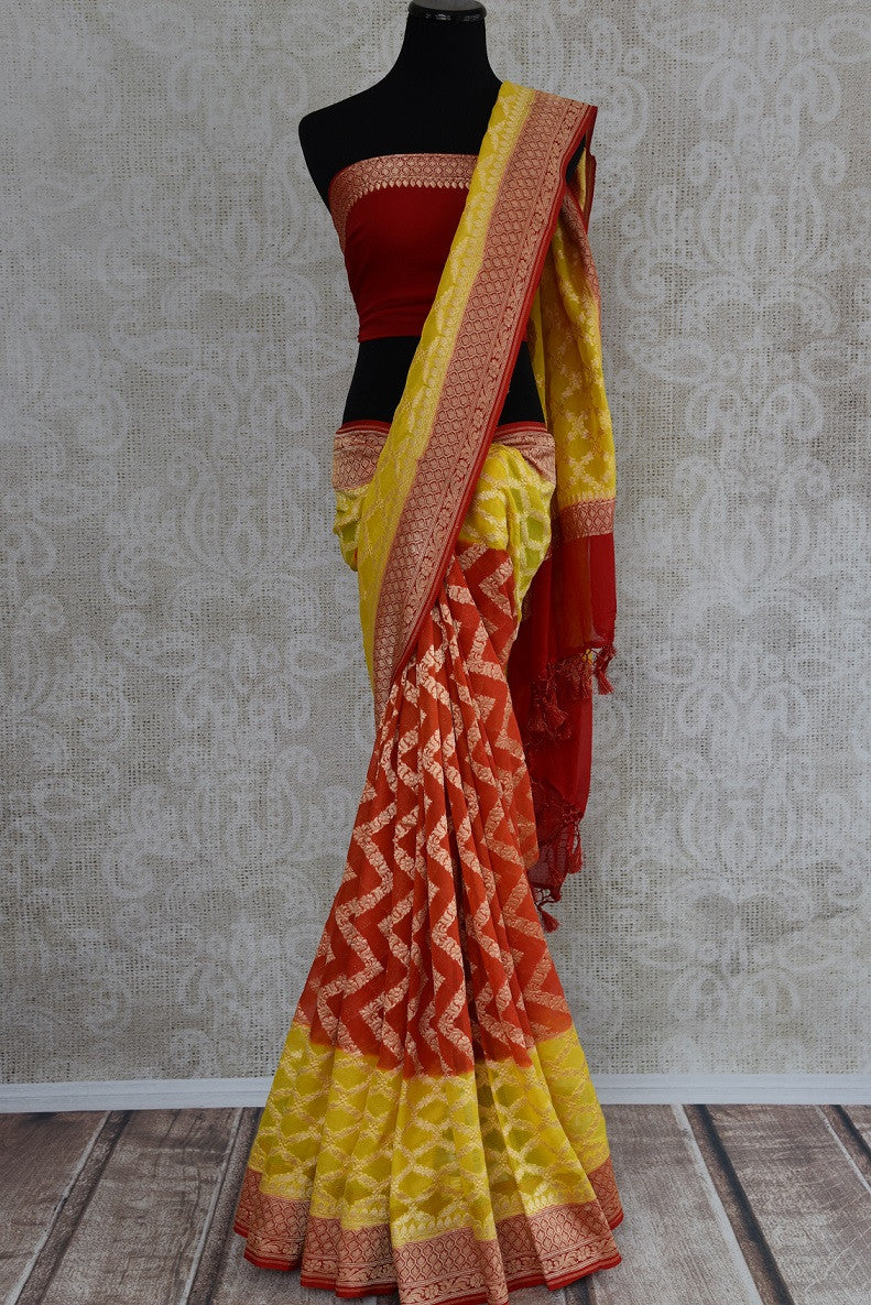90D352 Yellow, orange and red traditional saree that makes for a great ethnic outfit for Indian weddings. Buy this georgette Banarasi saree online at our Indian clothing store in USA - Pure Elegance.
