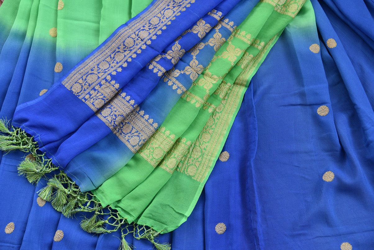 90D353 Blue and green, festive and party wear saree available online in USA at our ethnic wear store, Pure Elegance. The georgette Banarasi saree is an evergreen beauty and a must have in your Indian clothing collection.