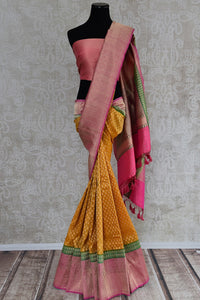 Ethnic and classic tissue banarasi saree with green and pink border and pallu. Perfect for all Indian events.-full view