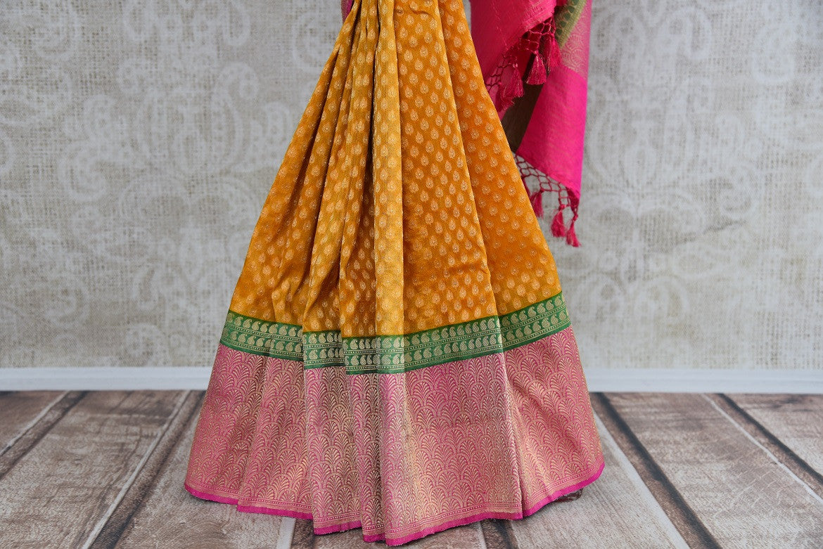 Ethnic and classic tissue banarasi saree with green and pink border and pallu. Perfect for all Indian events.-pleats
