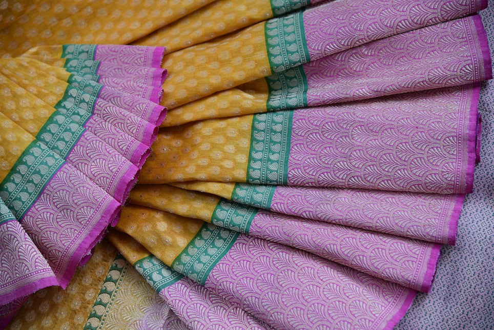 Ethnic and classic tissue banarasi saree with green and pink border and pallu. Perfect for all Indian events.-close up